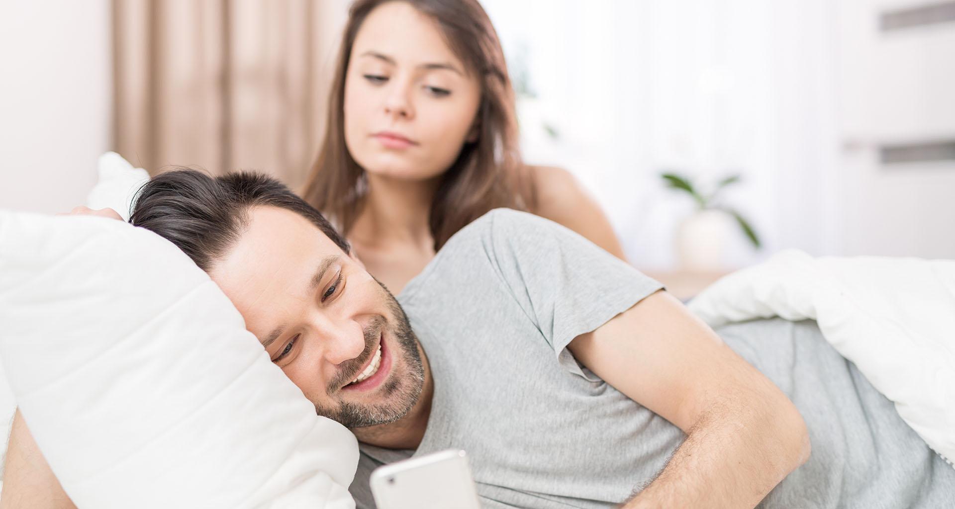 suspicious wife overlooks husband's phone