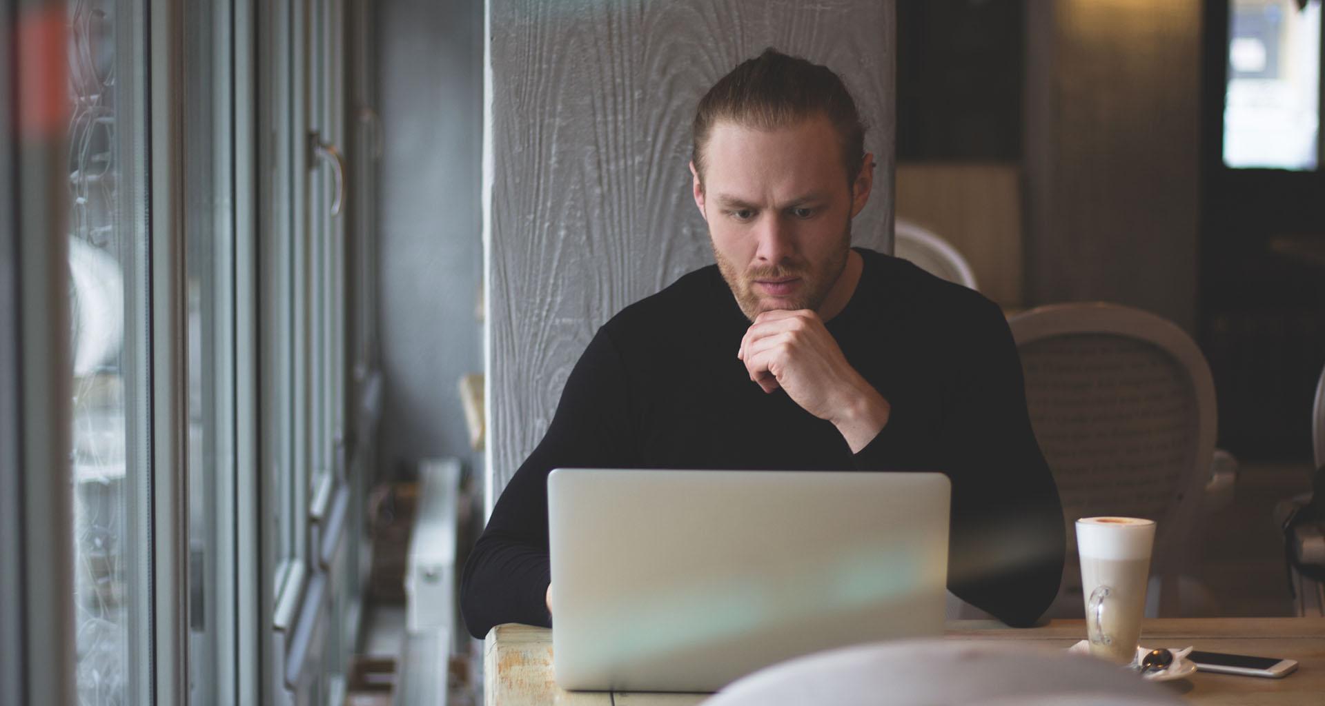 suspicious man uses internet search